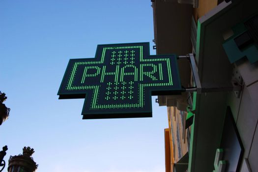 Neon Green Cross Sign Close-up