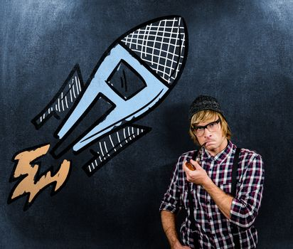 Serious blond hipster smoking a pipe against black background