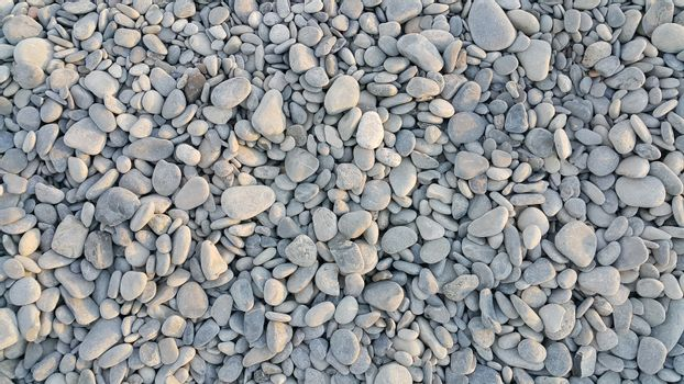 Nature background from gray sea pebbles