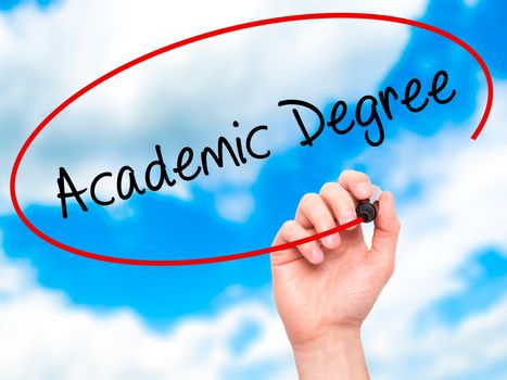 Man Hand writing Academic Degree with black marker on visual screen. Isolated on sky. Business, technology, internet concept. Stock Photo