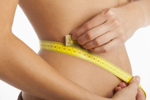 slim woman with a measuring tape