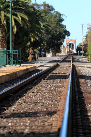 Train Station in Ventura California with a view of the tracks and train.