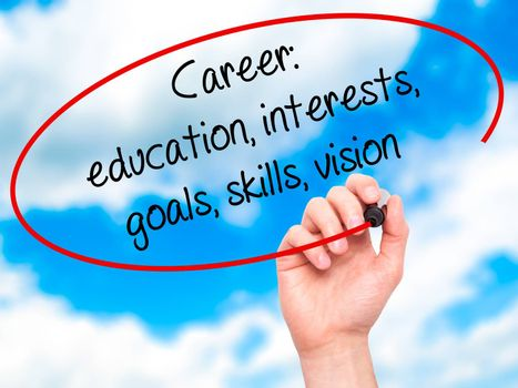 Man Hand writing Career: education, interests, goals, skills, vision with black marker on visual screen. Isolated on sky. Business, technology, internet concept.