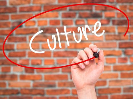 Man Hand writing Culture with black marker on visual screen. Isolated on bricks. Business, technology, internet concept. Stock Photo