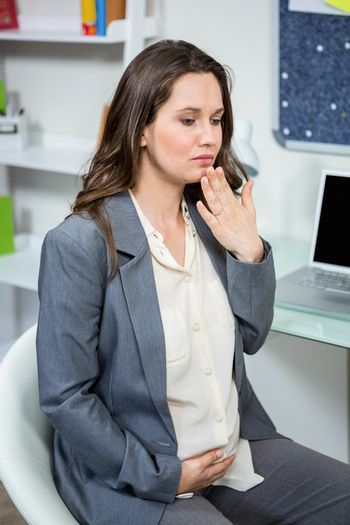 Pregnant businesswoman getting morning sickness