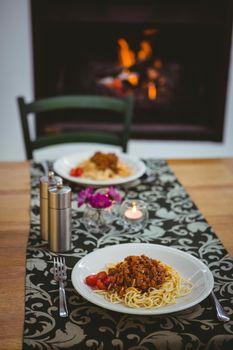 Plates of spaghetti on table