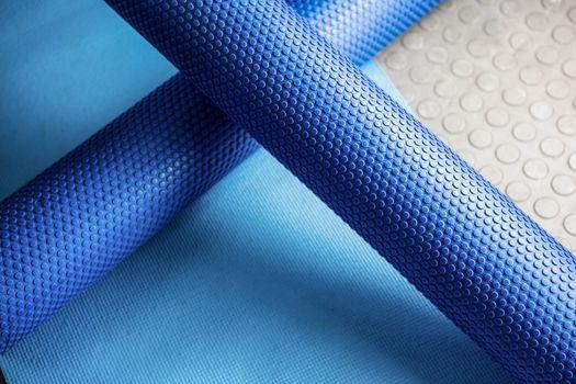 Foam roller on mat