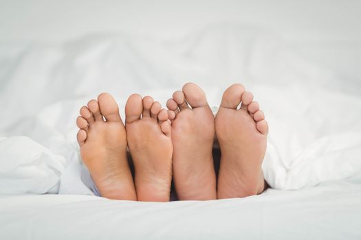 Feet sticking out from the blanket