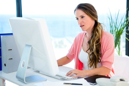 concerned business woman on her computer