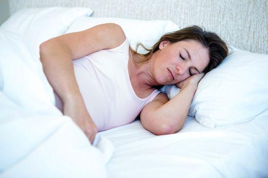 relaxed looking woman deep asleep