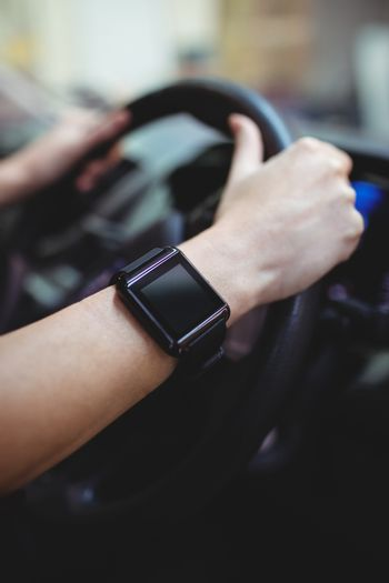 Close up of driver with smart watch