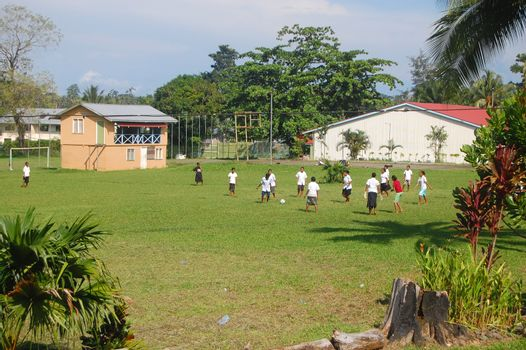 Women play soccer at high school campus