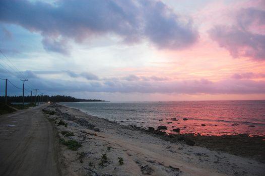 Gravel road between islands evening twilight Polynesia