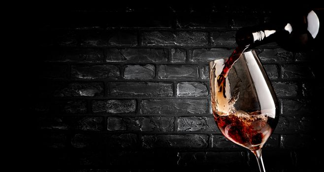 Pouring wine and brick wall