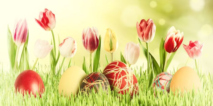 Easter vintage nature holiday background with eggs and flowers