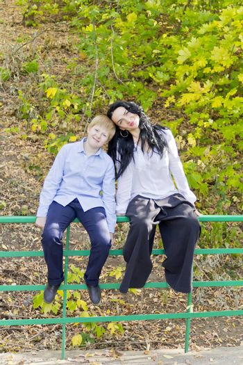 Photo of beautiful brunette and blond boy in autumn
