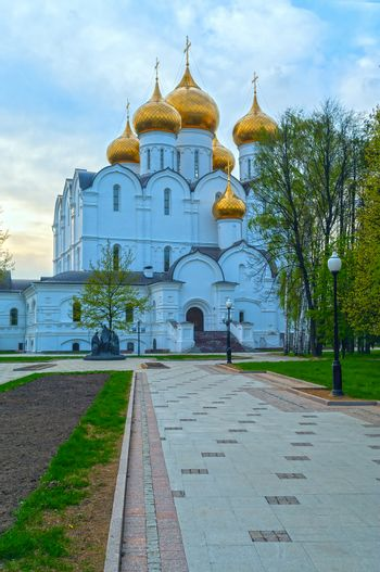 Ancient ortodox curch with golden domes in cloudy evening