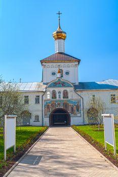 Entrance gate to white orthodox monastery