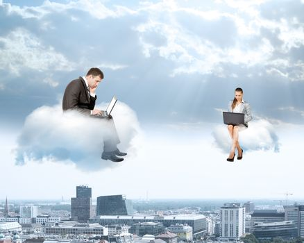 Business people working on laptops and sitting on clouds,  co-working concept
