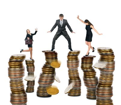 Business people standing on coins isolated on white background