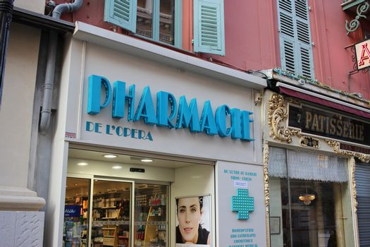 Nice, France - February 15 2016: Facade of a French Pharmacy in Nice. French Pharmacy Neon Blue Sign