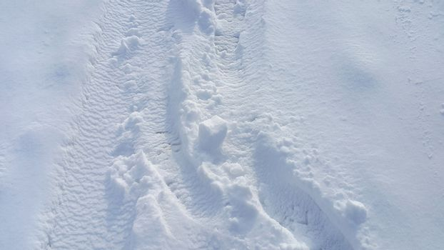 Footsteps on the snow background
