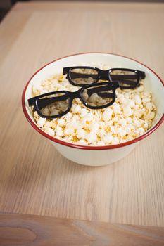 3D glasses in bowl of popcorn
