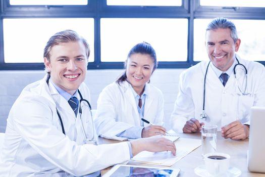 Portrait of medical team smiling at conference room