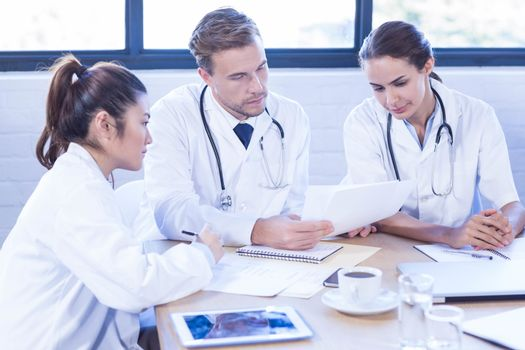 Medical team discussing in meeting at a conference room