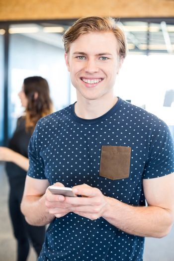 Man text messaging on smartphone