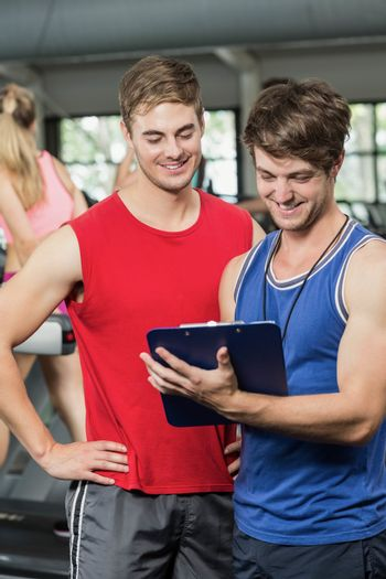 Male trainer discussing about performance