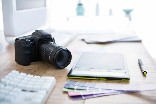 digital camera and colour swatches on an office desk