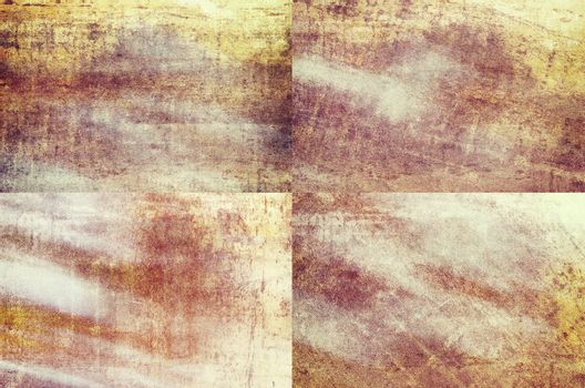 Four orange colored grunge texture backgrounds in one set
