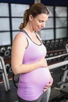 Pregnant woman in sportswear