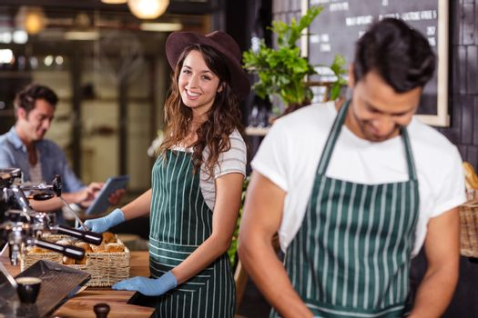Smiling barista looking at the camera