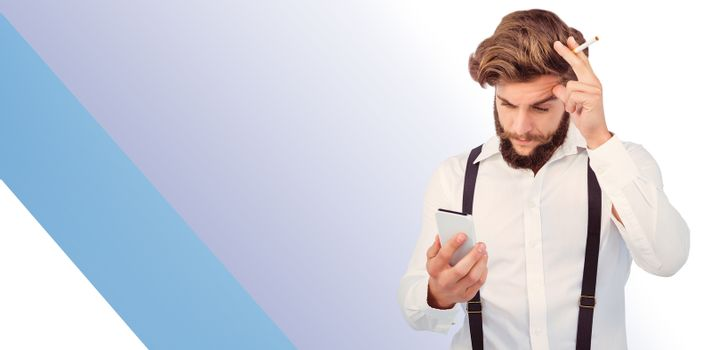 Hipster looking in mobile phonewhile holding cigarette against blue vignette background