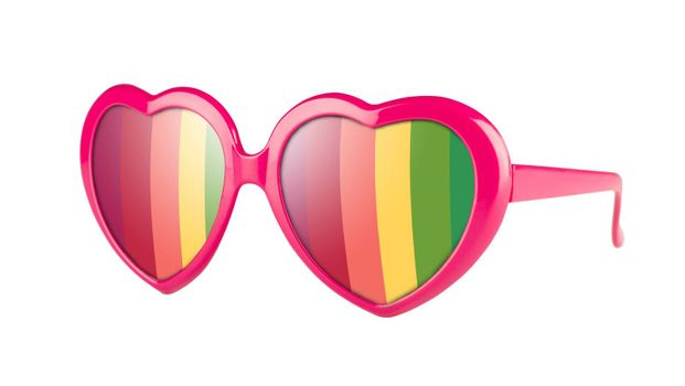 A pair of pink heart shaped pair of glasses with rainbow in the lenses, isolated on white.