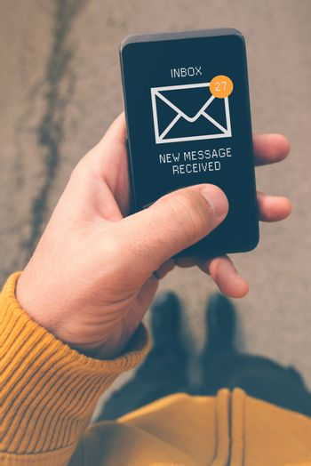 Using mobile smartphone to access e-mail inbox