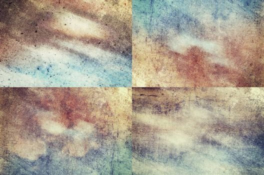 Four colored grunge texture backgrounds in one set