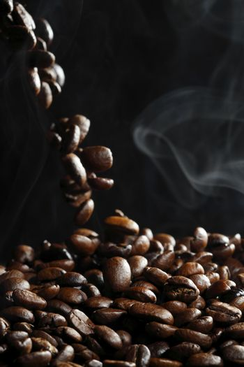 Falling coffee beans with steam