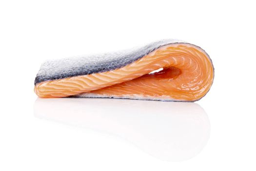 Raw salmon steak isolated on white background. Sashimi sushi. Luxurious healthy seafood eating.