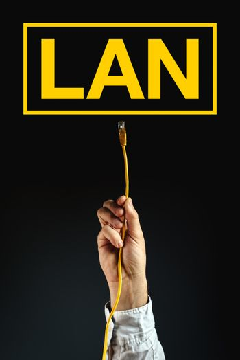Businessman plugging LAN cable to connect to network