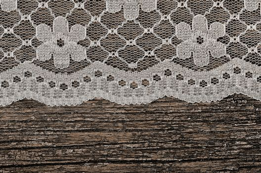 Openwork lace on wooden background
