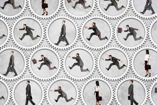 Businessmen running inside gears on grey background, business concept
