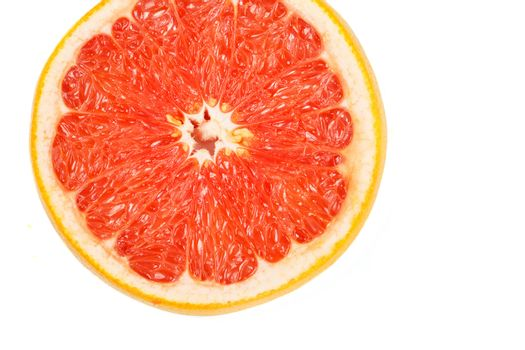 Slice a fresh juicy red round grapefruit
