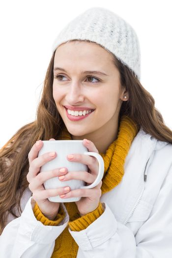 Pretty woman in winter clothes drinking a hot beverage