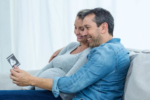 Couple looking at ultrasound scan
