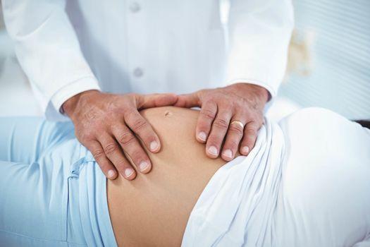 Doctor examining pregnant woman