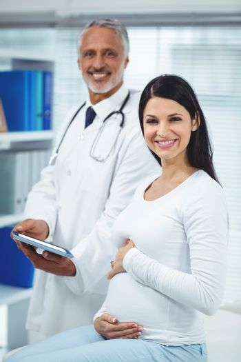 Pregnant woman interacting with doctor