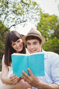 Young couple reading a novel